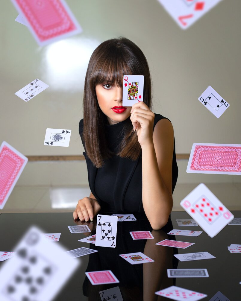 Female magician playing with card tricks
